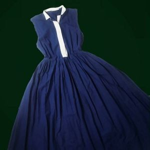 Vintage late 1940s fit and flare sleeveless dress.